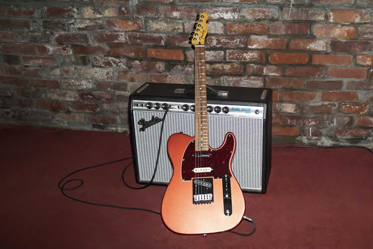 Player Plus Nashville Telecaster leaning against amp
