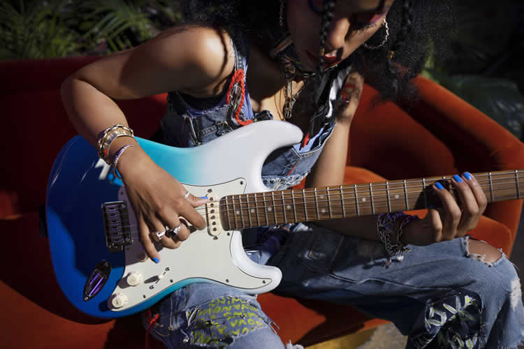 Guitarist with Player Plus Stratocaster HSS