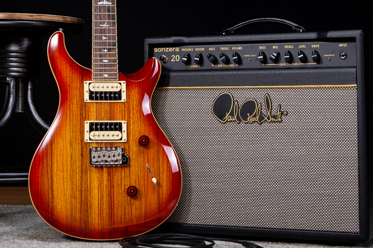 Stylized image of PRS CE Custom 24 guitar and Sonzera 20 amp