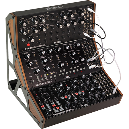 3/4 view of Moog DFAM, Moog Mother-32 and Moog Subharmonicon in 3-tier rack showing top, left side and front edge