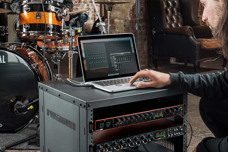 Image of man recording band with Focusrite interface