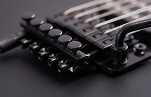 detail image of EVH 5150 Standard showing EVH-branded Floyd Rose locking tremolo bridge