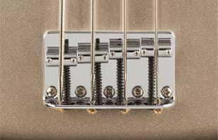 detail top view of Fender 75th Anniversary Precision Bass showing 4-saddle bridge with slotted saddles