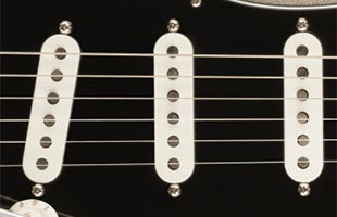 detail view of Fender 75th Anniversary Stratocaster showing vintage-style 60s pickups