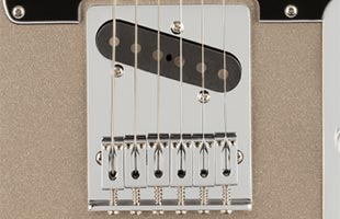 detail view of Fender 75th Anniversary Telecaster showing 6-saddle string-through-body Telecaster bridge