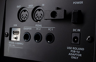 closeup of Roland A-88MKII rear panel showing MIDI and USB connections