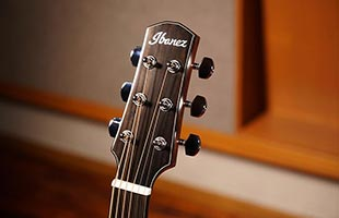 detail view of Ibanez AAD100EOPN acoustic guitar showing top of headstock