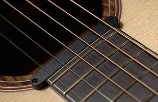 detail image of Ibanez AAD100EOPN acoustic guitar showing Ibanez AP11 magnetic pickup