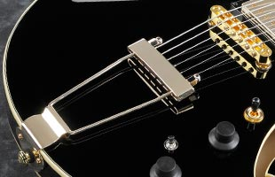 detail image of Ibanez AMH90 showing Gibraltar Performer bridge with VT06 tailpiece