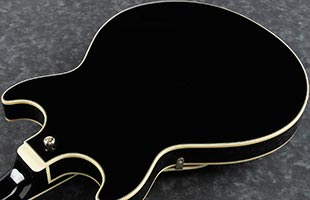 close-up perspective view of Ibanez AMH90 body showing back and right side