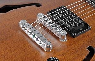 detail image of Ibanez AS53 Artcore Semi-Hollow Guitar showing Gibraltar Performer bridge