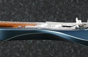 side profile close-up view of Ibanez AZ2204B showing ergonomic rear body contours
