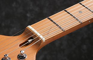 detail image of Ibanez AZ2204B showing portion of headstock and fingerboard