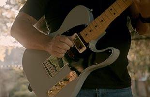close-up image of Brent Mason playing Fender Brent Mason Telecaster outdoors