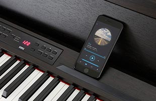 close-up top view of Korg C1 Air with Bluetooth-connected smartphone on music rest