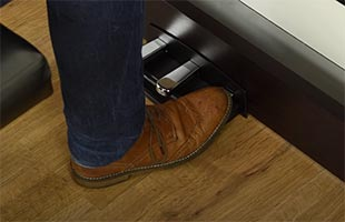close-up image of musician's foot pressing sustain pedal on Korg C1 Air