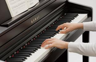 detail image of hands playing Kawai CA49 digital piano