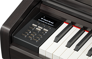 detail of Kawai CA59 digital panel showing control panel and portion of keybed