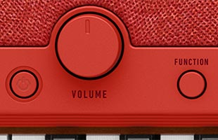 detail image of Casio Casiotone CT-S1 - Red control panel showing power button, volume knob and FUNCTION button