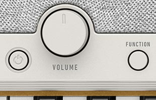 detail image of Casio Casiotone CT-S1 - White control panel showing power button, volume knob and FUNCTION button