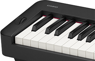 detail image of left edge of Casio CDP-S350 digital piano showing pitch bend wheel and portion of keybed