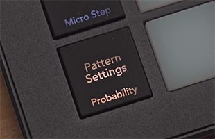 detail image of Novation Circuit Tracks control panel showing Patterns Settings and Probability button with amber lamp lit