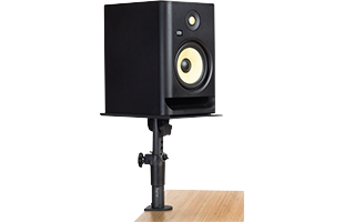 Gator Frameworks Clamp-On Studio Monitor Stand attached to desk with studio monitor on it in vertical orientation