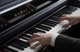 closeup of hands playing Kawai CN39 piano