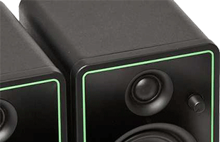 detail view of Mackie CR-X monitors showing front panel control knob