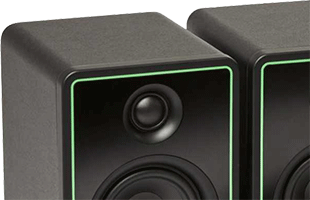 detail view of Mackie CR-X monitors showing brushed metal front panel with detail outline stripe