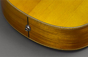 detail image of Yamaha CSF1M acoustic guitar underside showing strap button and pickup location