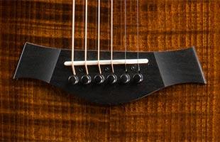 detail image of Taylor Custom Catch 12 GA Blackwood/Blackwood showing bridge saddle