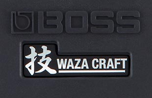 detail top view of Boss DC-2W Dimension C Waza Craft guitar chorus effects pedal showing Boss and Waza Craft logos on main stomp switch