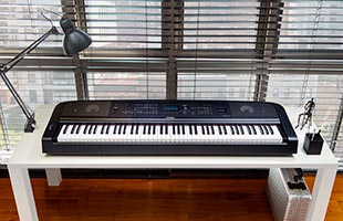 front view of Yamaha DGX-670 on table in living room