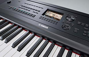 close-up image of Yamaha DGX-670 showing color screen, control panel and portion of keybed