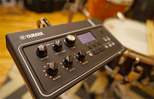 view of top and left side of Yamaha EAD10 module with snare drum in background