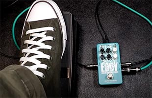 close-up top view of guitarist foot on expression pedal alongside Electro-Harmonix Eddy