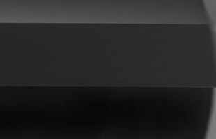 detail image showing rubberized black finish on rear panel of Korg EK-50 L
