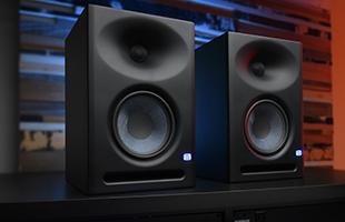 studio image showing pair of PreSonus Eris E7-XT studio monitors
