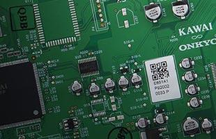 detail image of Kawai ES520 digital piano motherboard bearing Kawai and Onkyo logos