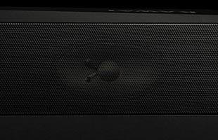 detail image of Kawai ES520 digital piano speaker grille with speaker cone visible underneath