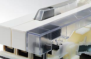 3-D illustration with cutaway and transparent key showing Kawai ES920 key counterweight construction