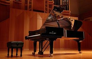 Shigeru Kawai SK-EX concert grand piano in concert hall