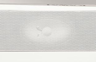 detail image of Kawai ES920 digital piano speaker grille with speaker cone visible underneath