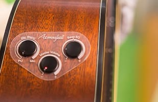 detail image of Yamaha Red Label acoustic guitar showing Atmosfeel pickup and preamp system control knobs