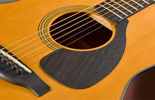 close-up top image of Yamaha Red Label acoustic guitar showing solid sitka spruce top