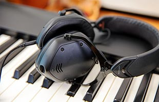 close-up image of headphones resting on Roland FP-30X keybed