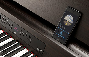 detail image of Korg G1B Air digital piano keybed and music rest with smartphone resting on the music rest