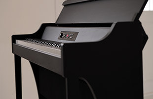 profile view of Korg G1B Air digital piano showing right side and front