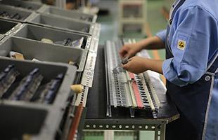 Korg factory worker assembling Korg RH3 piano keybed mechanism
